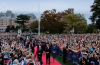 Thousands crowd legislature grounds to greet royal couple